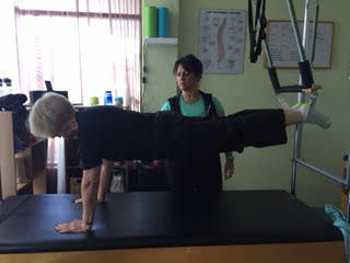 This is our client Jill preforming the Plank Pushup on the Trapeze Table